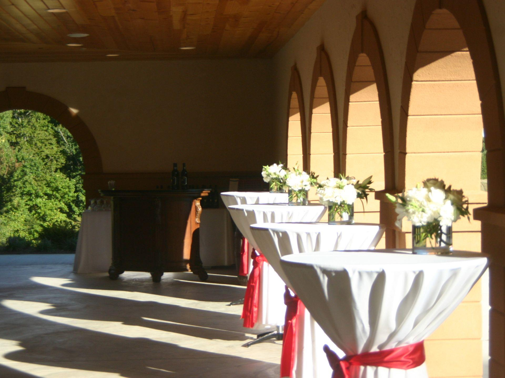Tables set up in a hallway for a catering event