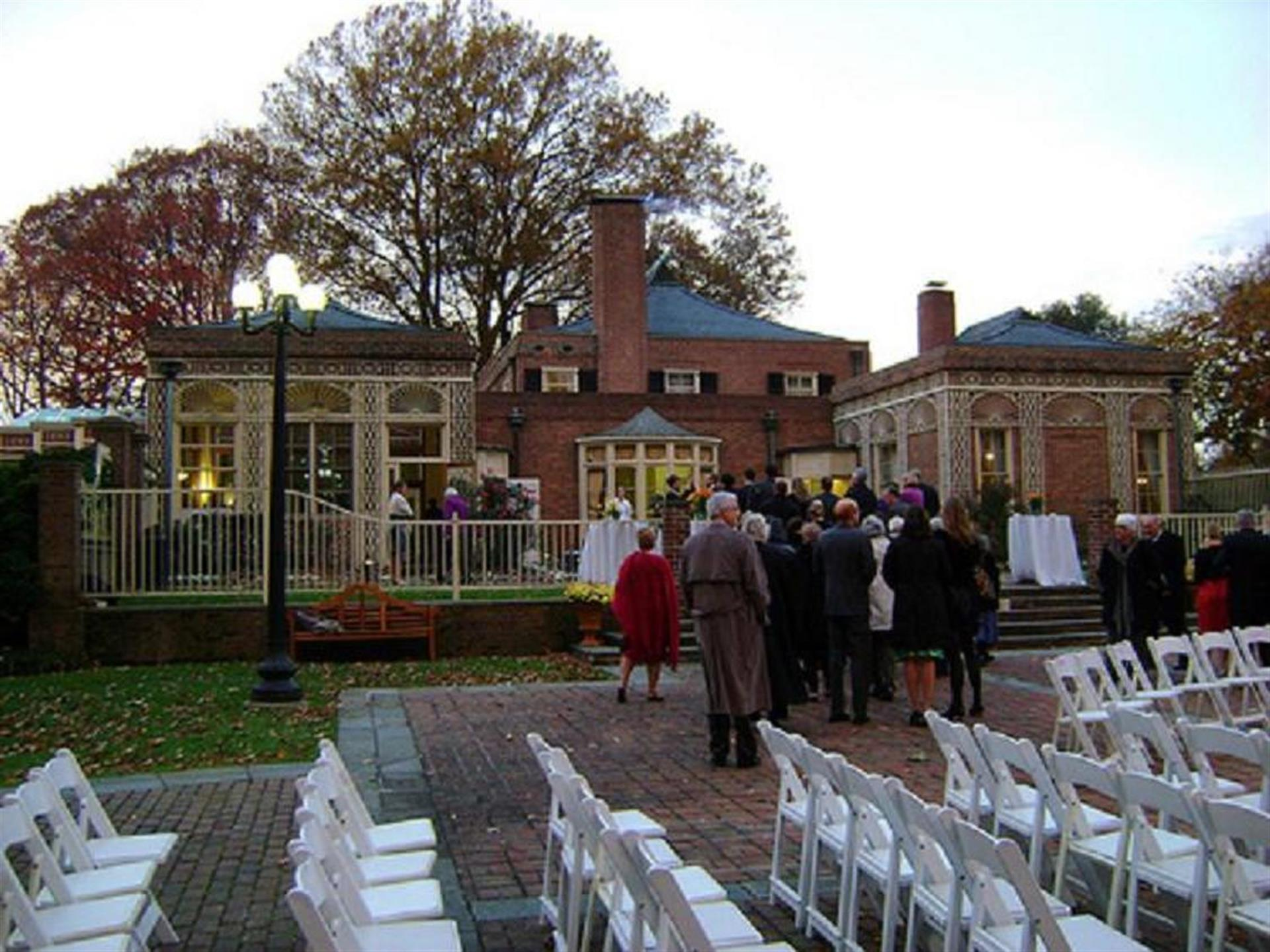 Outdoor patio area with a group of people gathered