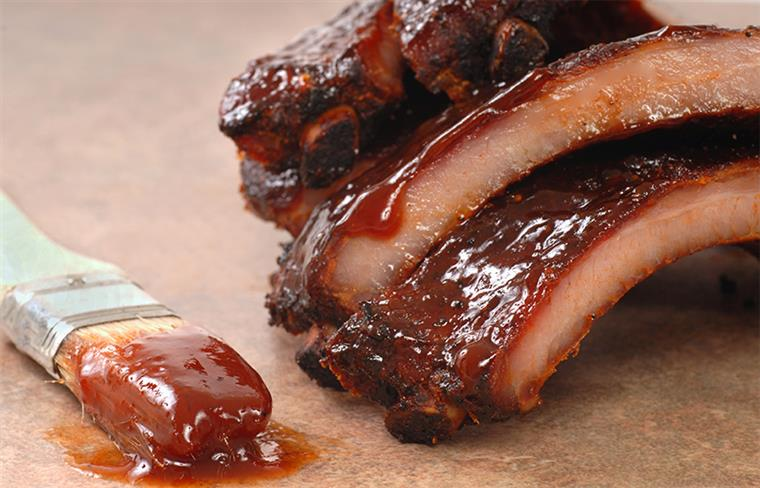 Ribs brushed with barbeque sauce