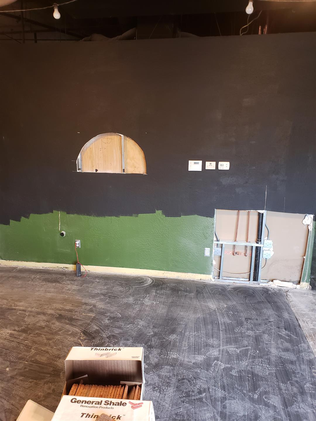 painting mural on wall during building renovations