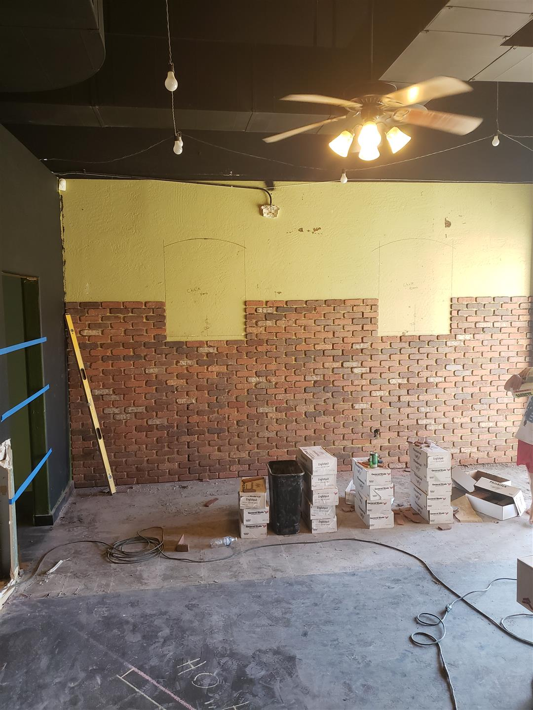 interior view of renovations on building - laying down brick