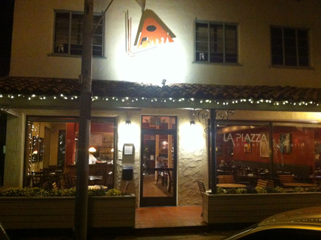 outside of la piazza pizzeria showcasing their outdoor seating