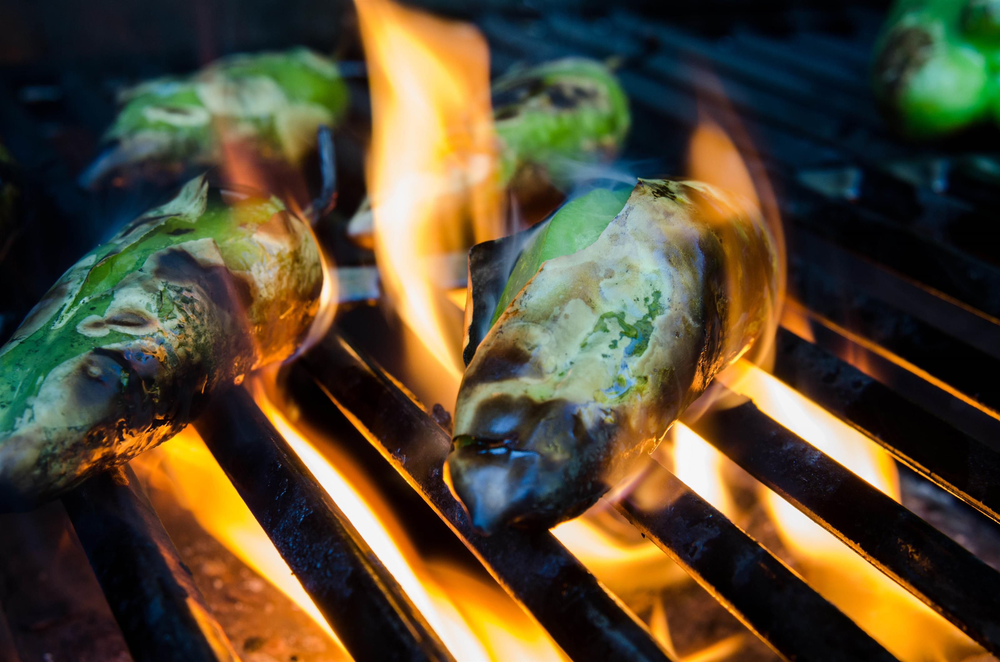 Fire roasted jalapenos on a grill