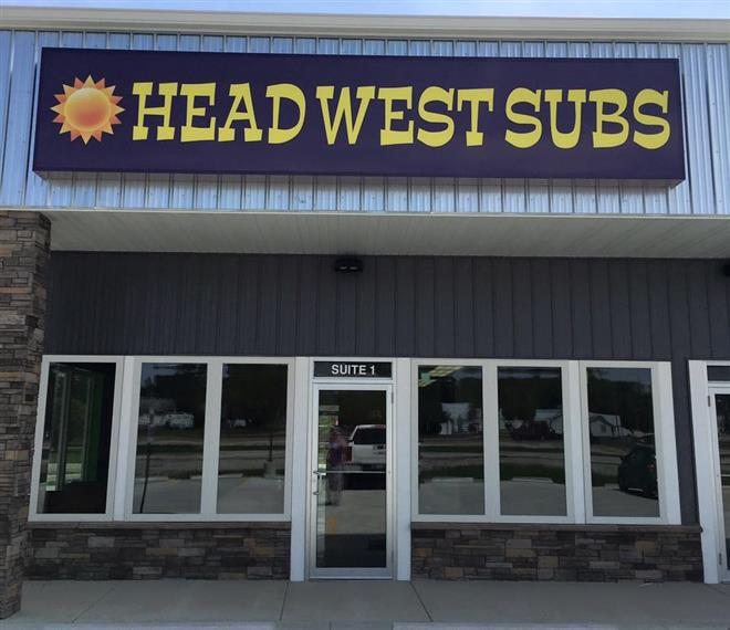 Storefront Head West Subs sign over entrance