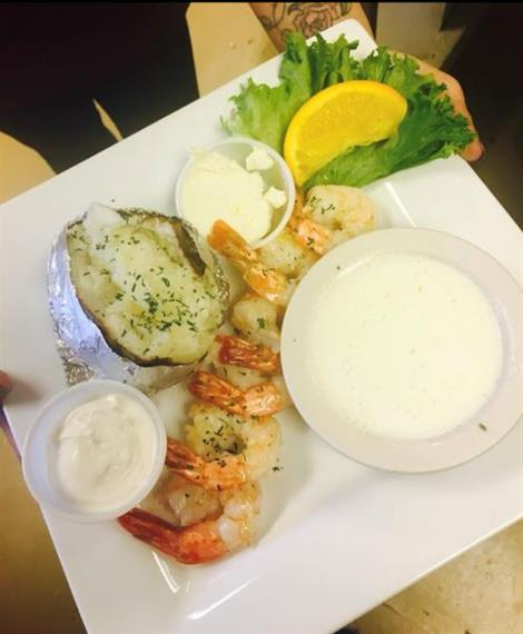 shrimp scampi skewers with side of potato and cup of butter
