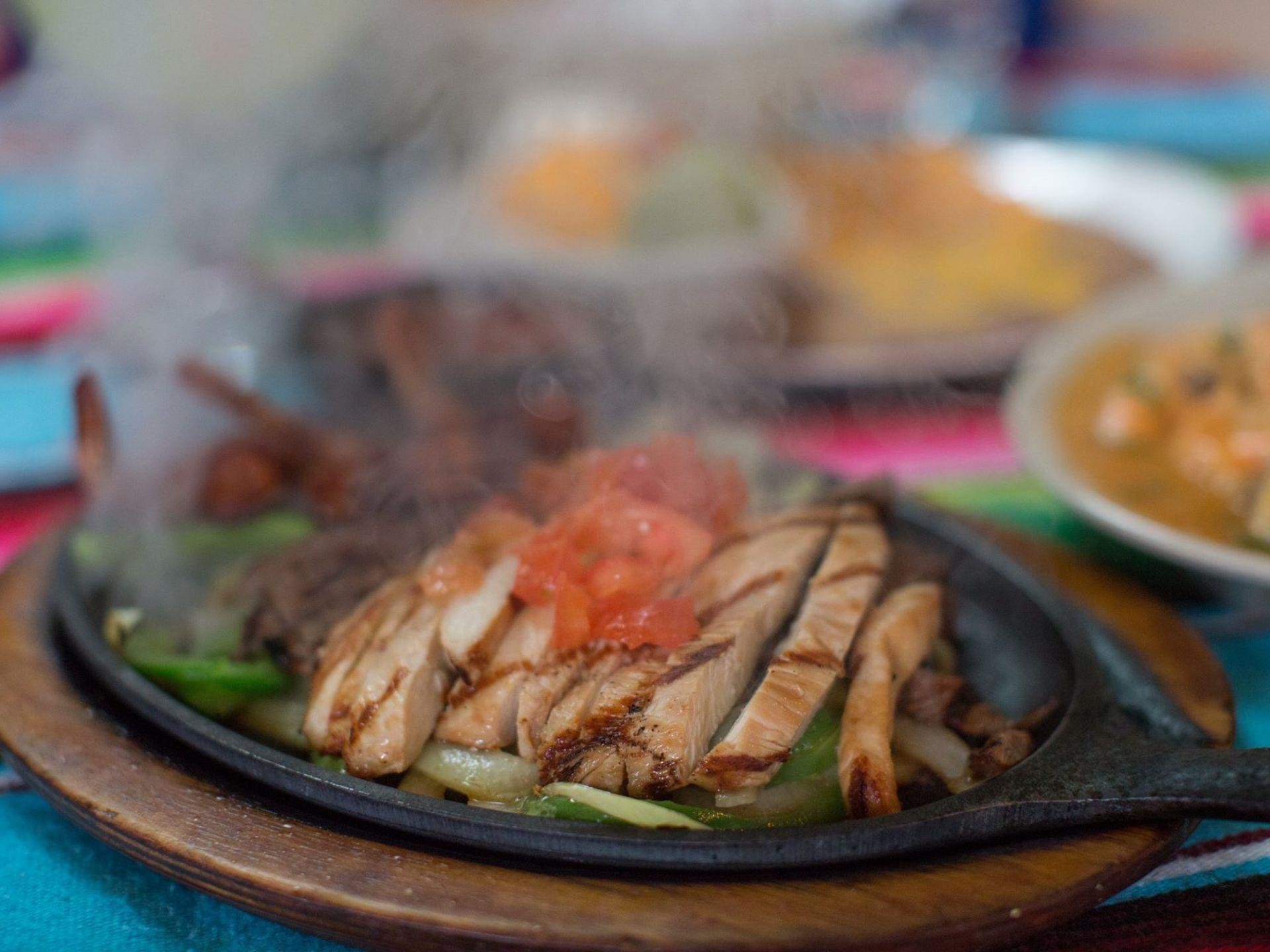Chicken fajita in a skillet with vegetables