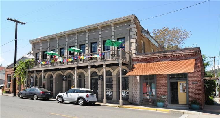 Outside view of La Fiesta with tables on a balcony
