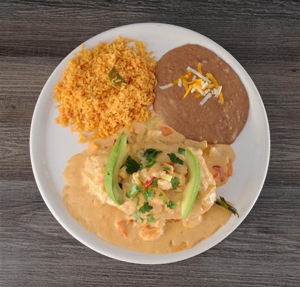 Chile Relleno with a side of beans and rice on a plate