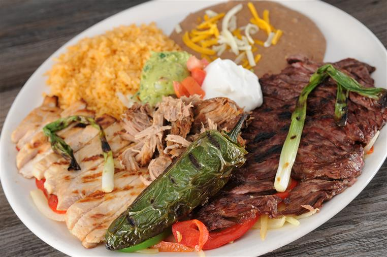 El Paraiso Plate with a side of beans and rice
