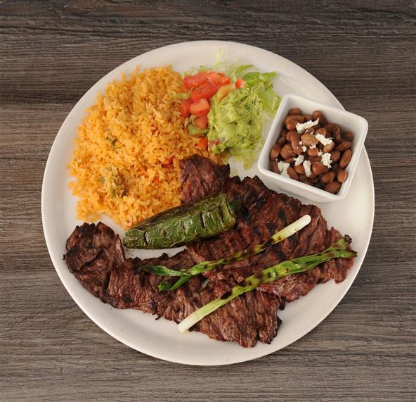 Carne Asada with a side of rice, side of beans and guacamole