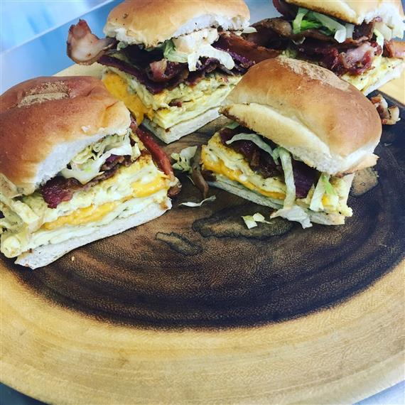 bacon cheeseburgers with lettuce tomato and sauce