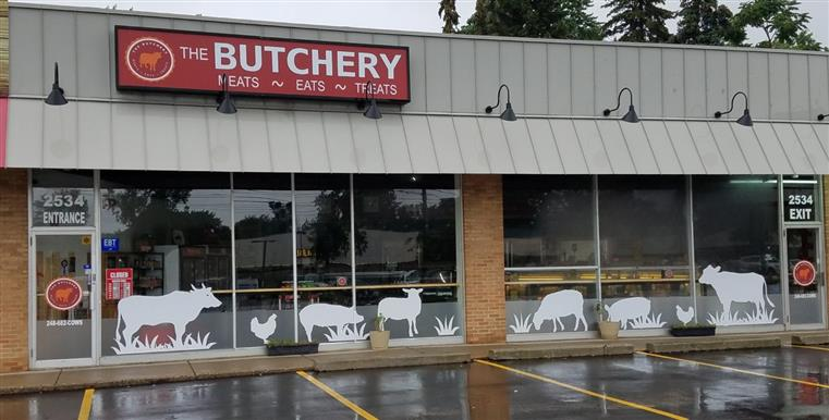 exterior shot of the butchery with animal decals on windows