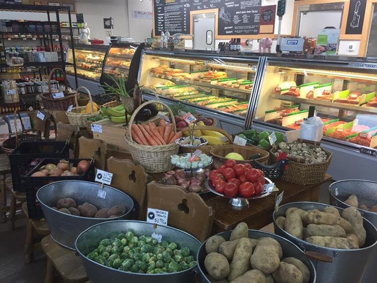 interior shot of deli counter with fresh produce