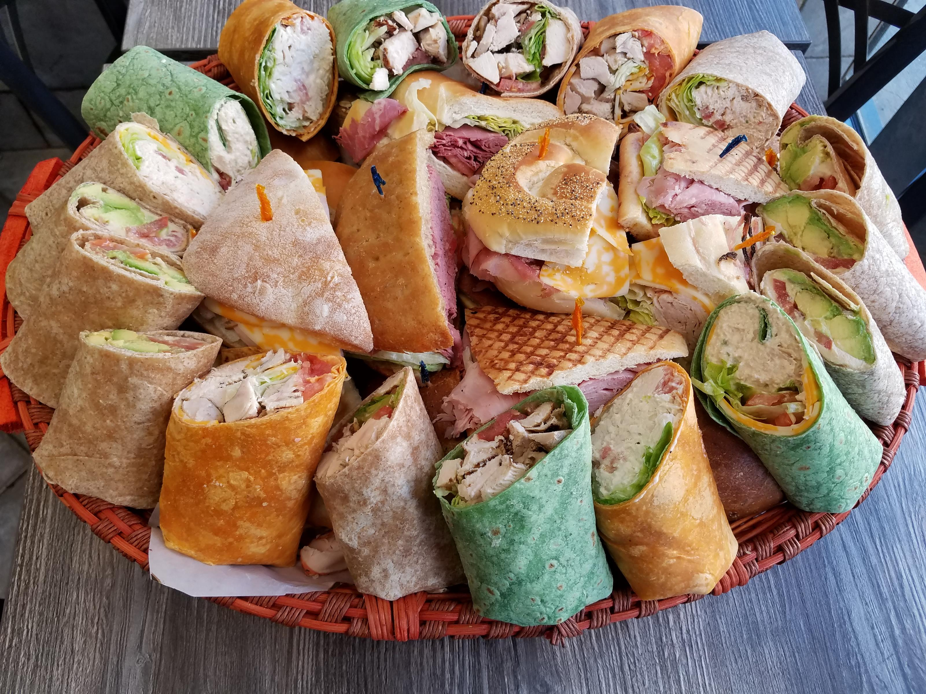 Assorted sandwiches and wraps on a tray