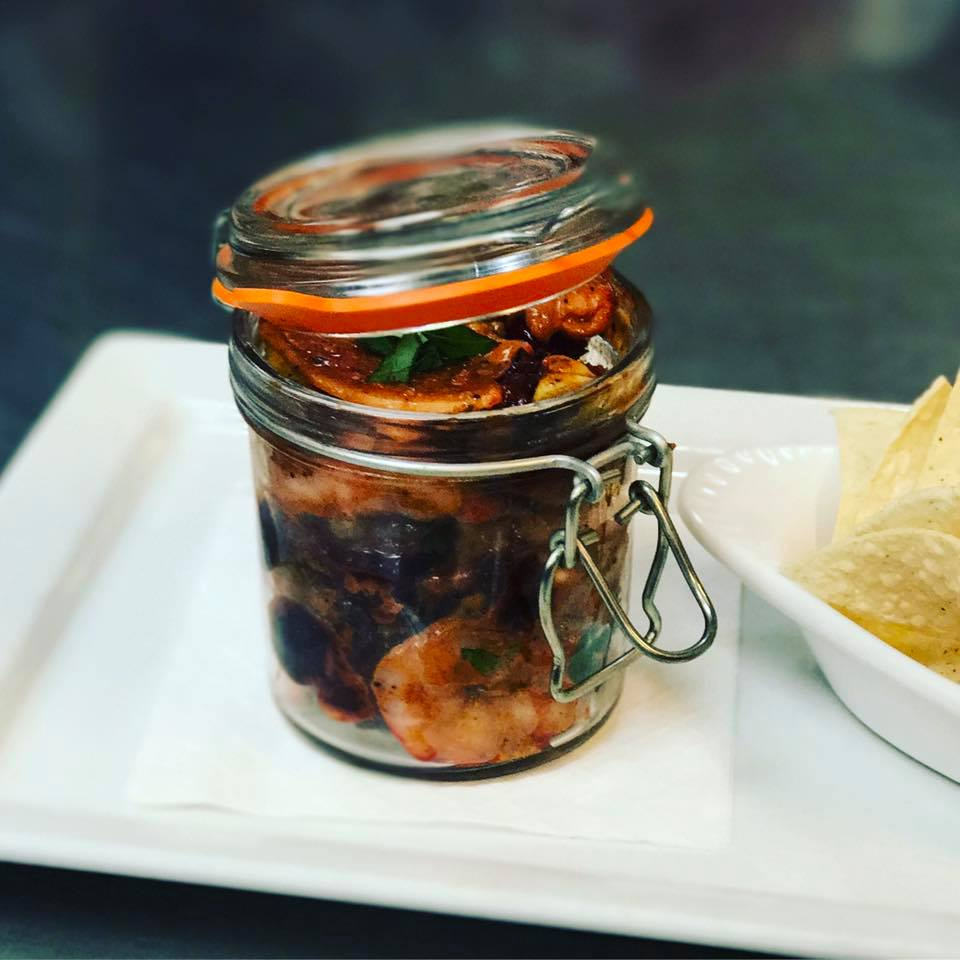 Shrimp marinara in a glass jar