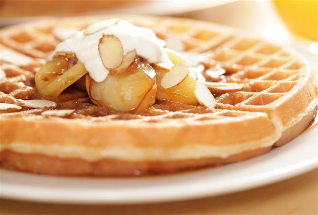waffle topped with banana, syrup & almonds