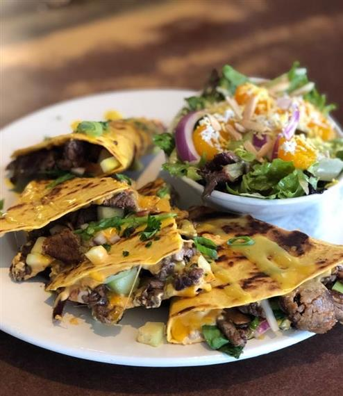 grilled steak quesadilla with a side salad