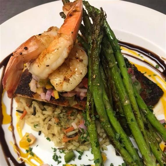 grilled shrimp and salmon on a bed of rice topped with asparagus