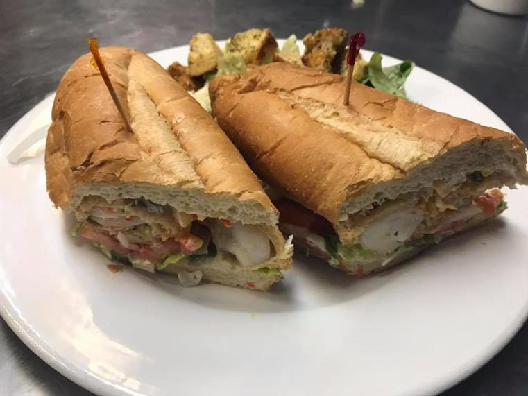 chicken and vegetable sandwich on a plate