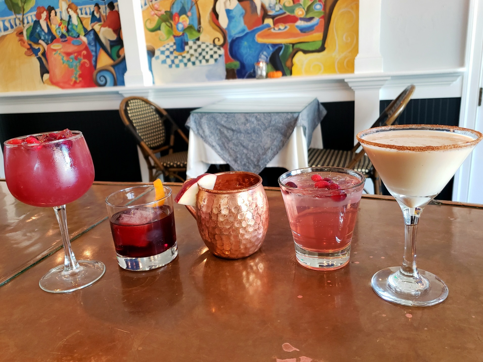 cocktails lined up on a table