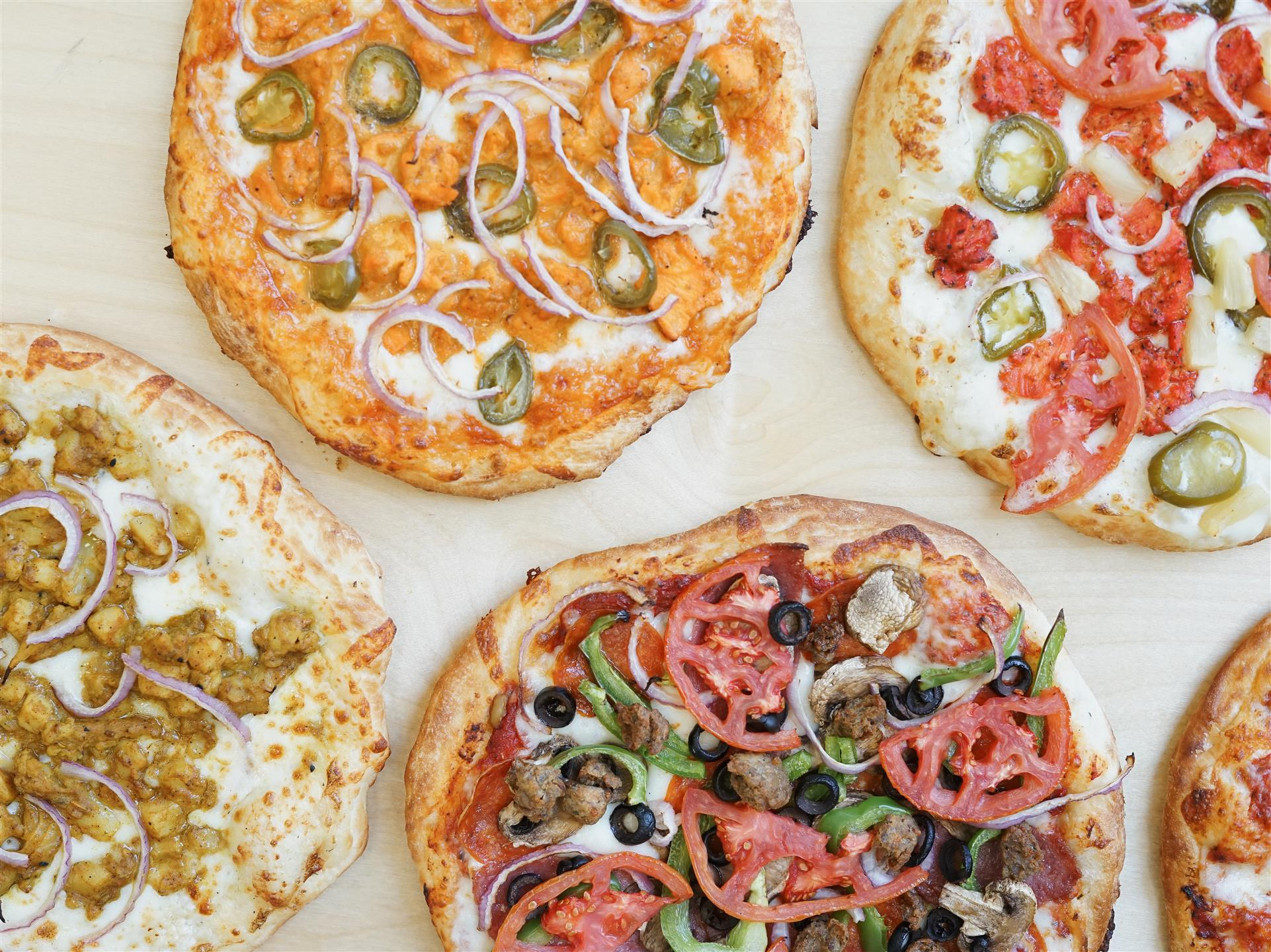 4 different types of pizzas with different toppings
