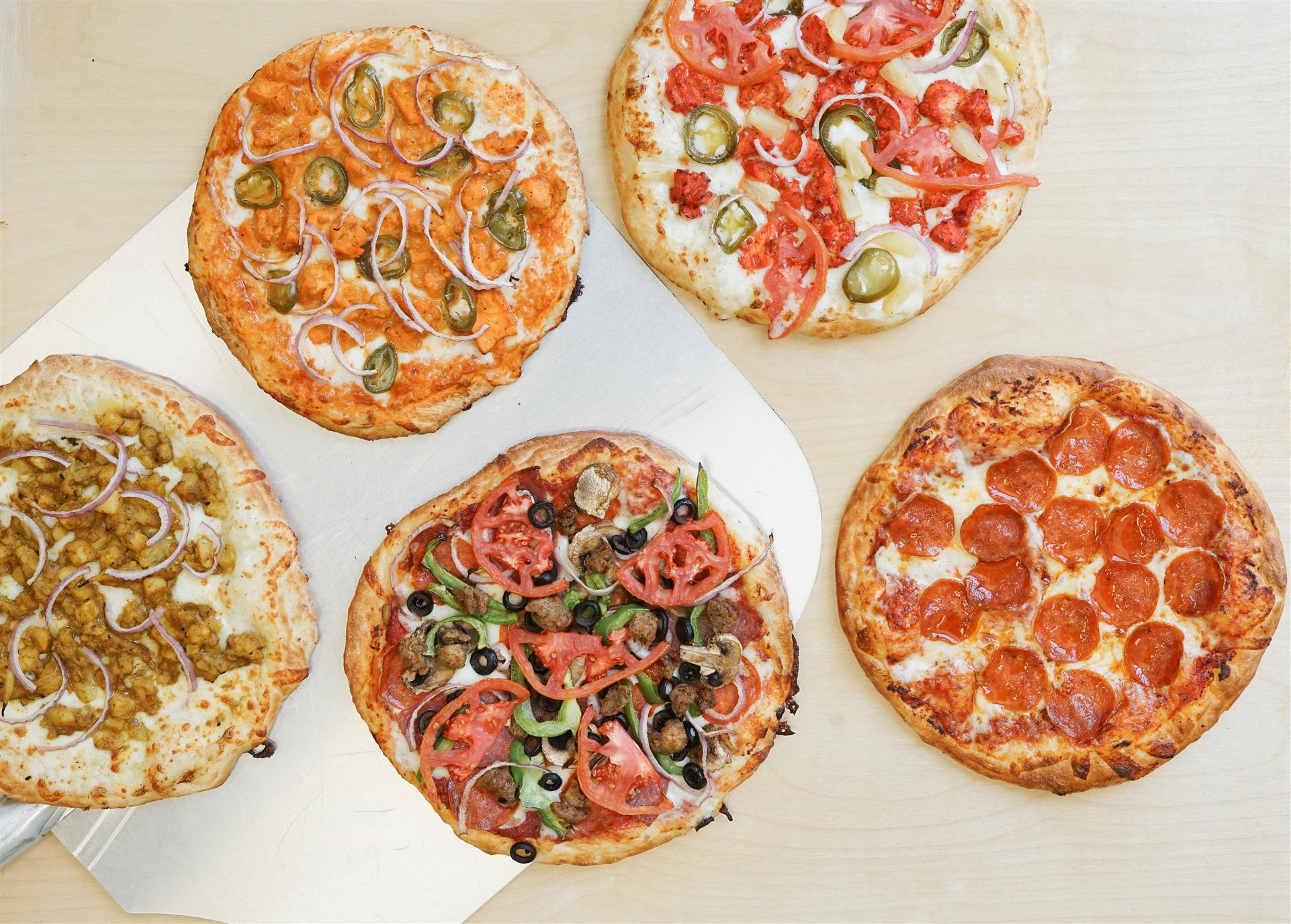 5 different types of pizzas with different toppings