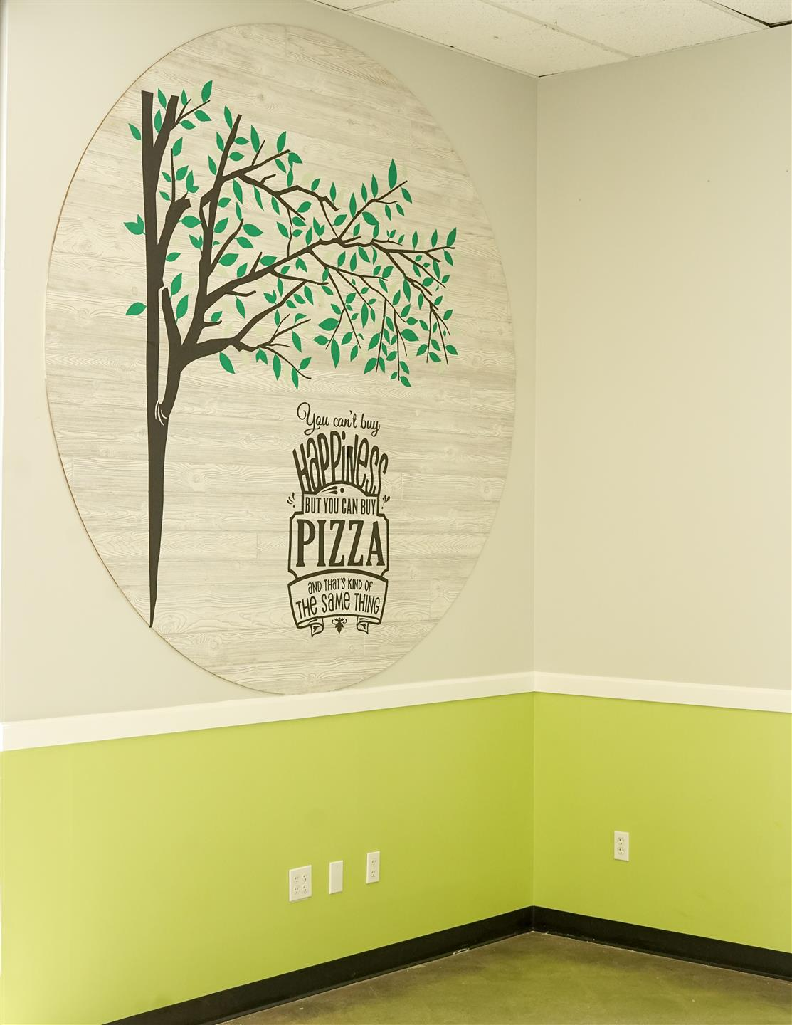photo of tree artwork on the wall inside