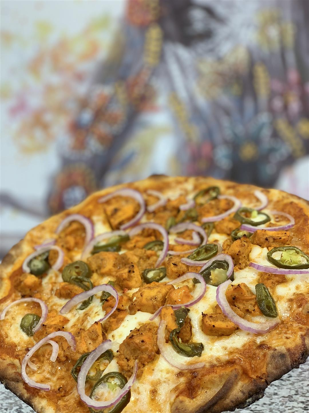 pizza with meat, onions and jalapenos