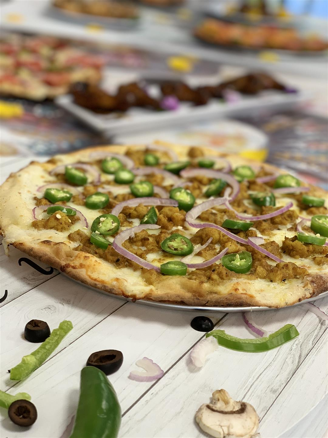 Pizza with meat, jalapenos and onions