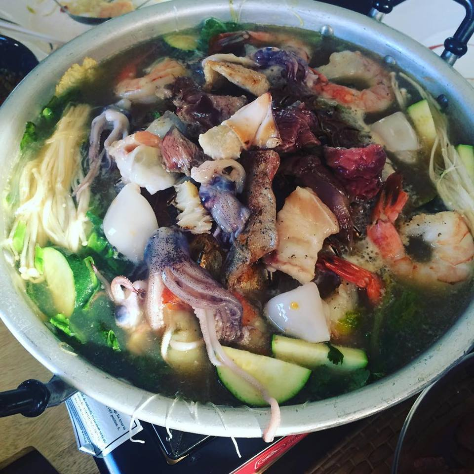 Thai seafood soup with squid and shrimp with assorted vegetables