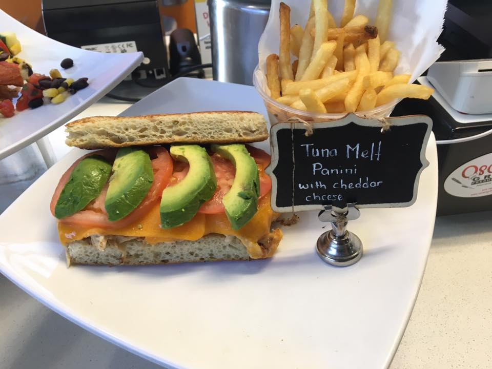 Tuna melt panini with cheese, tomatoes and sliced avocados with fries