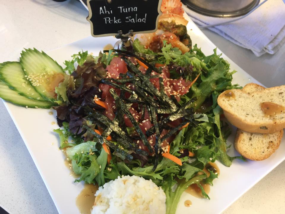 Ahi tuna poke salad with cucumbers and sliced bread