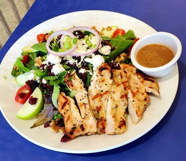 Grilled chicken salad with dressing on the side