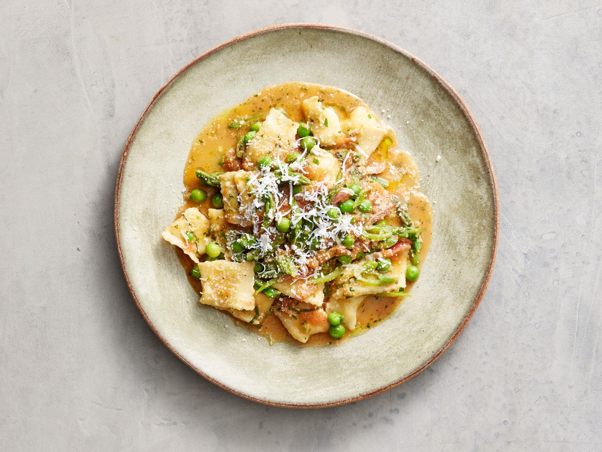 Agnolotti dal plin with peas aspatagus and panchetta