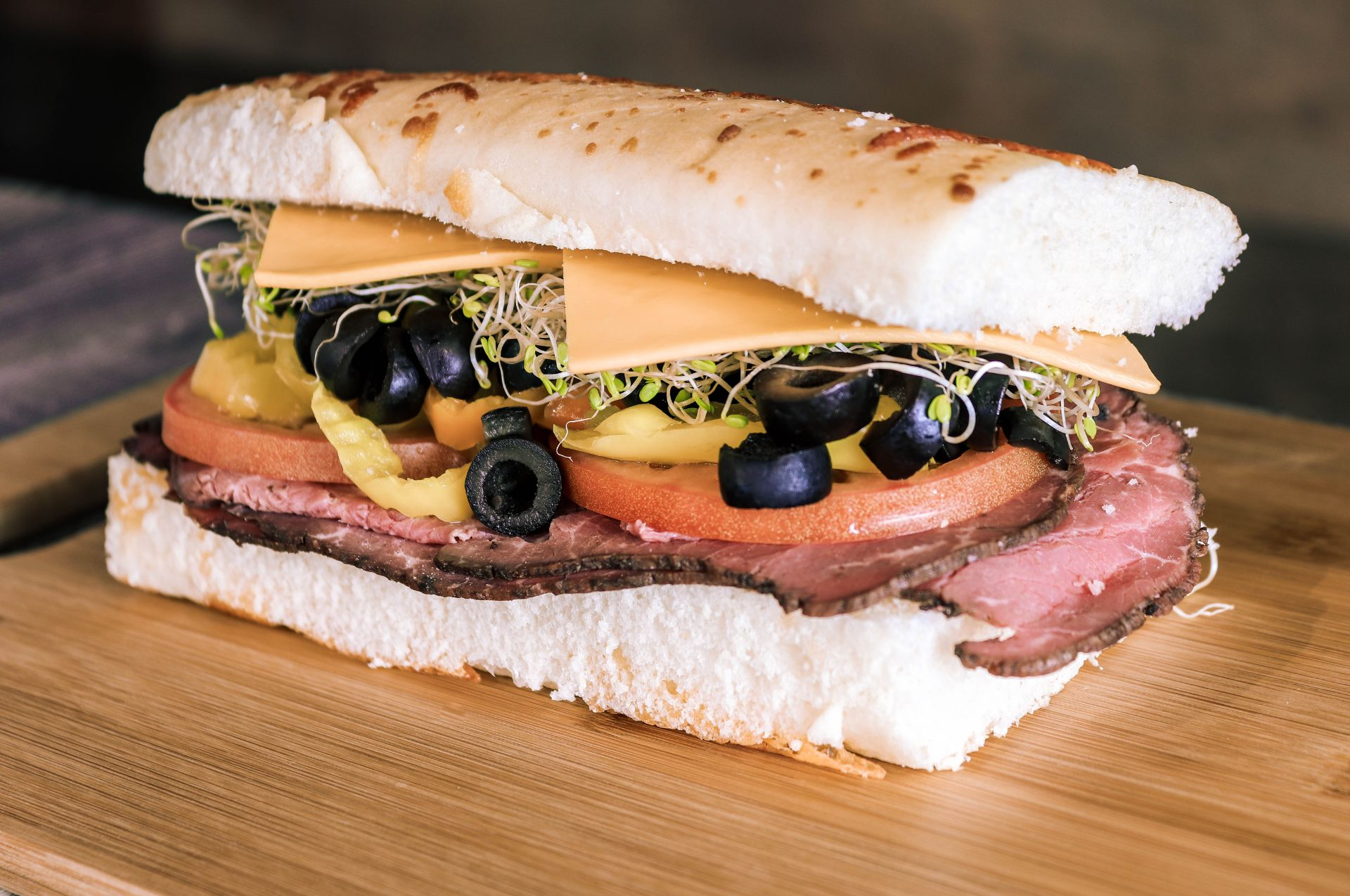 The rum runner. Hot Pastrami sandwich with lettuce, tomato, black olives and cheese
