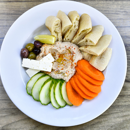 pita slices and vegetables with hummus