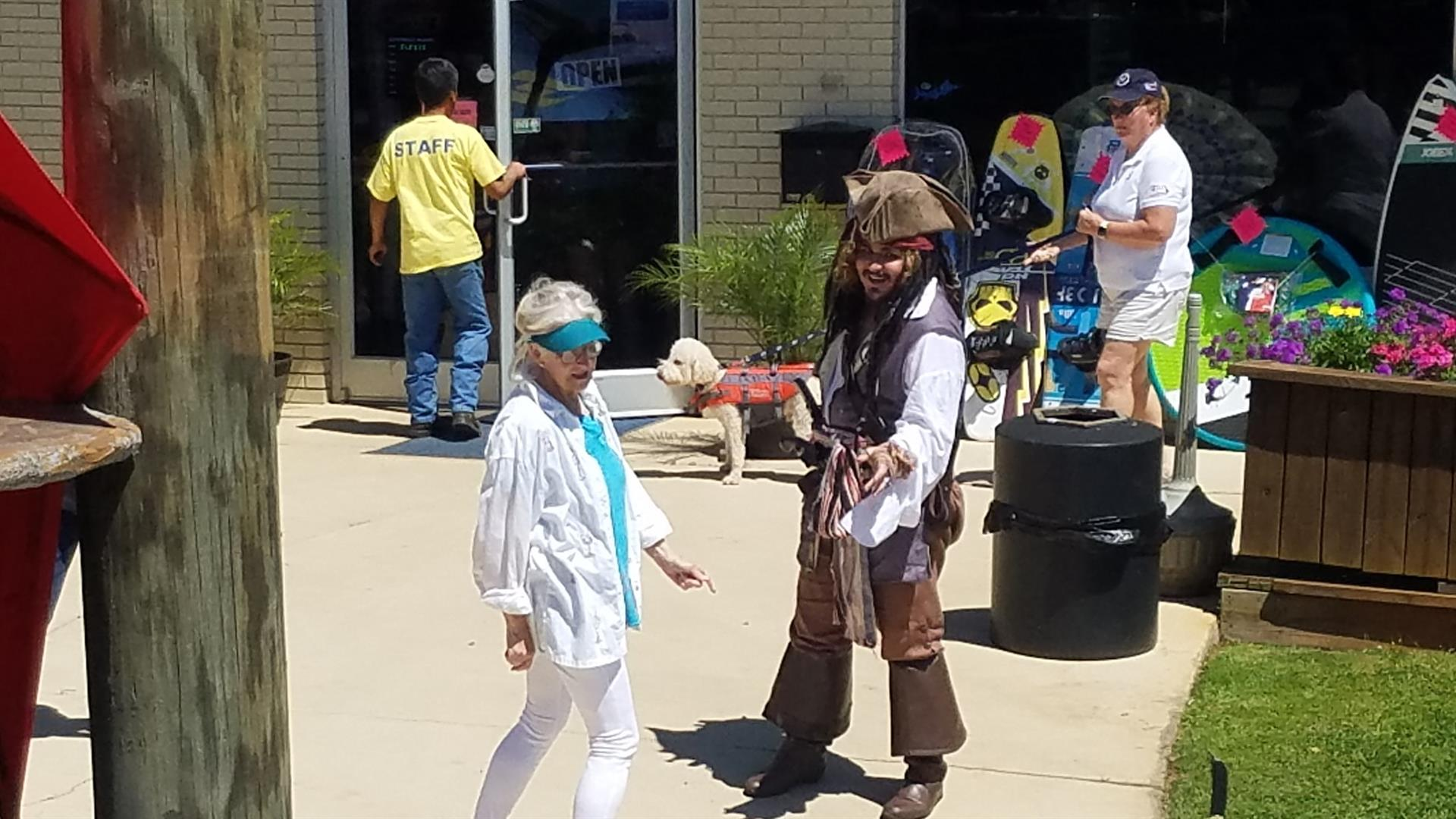 Man in a pirate costume and an older woman walking