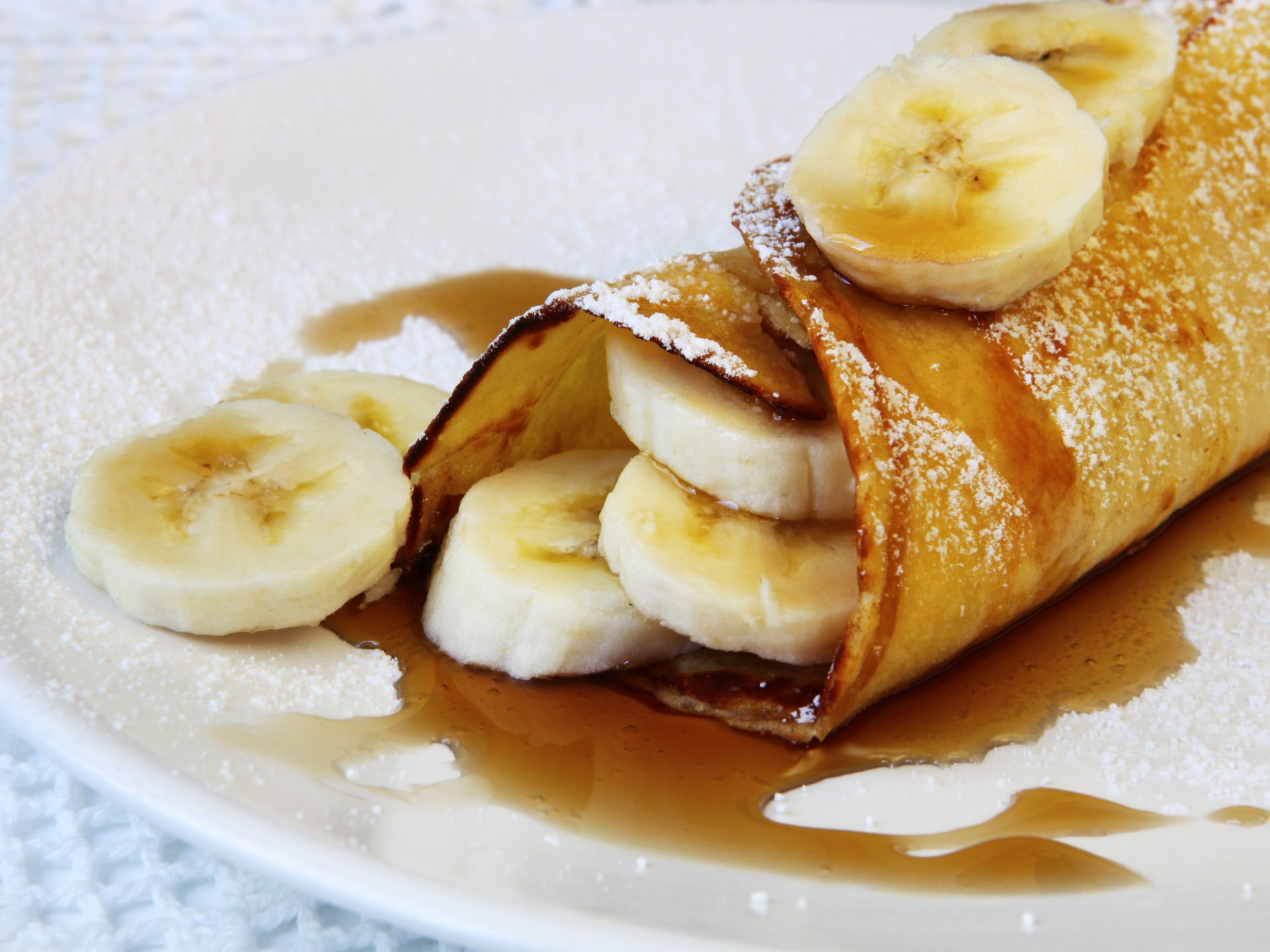 Crepe with Bananas covered in maple syrup