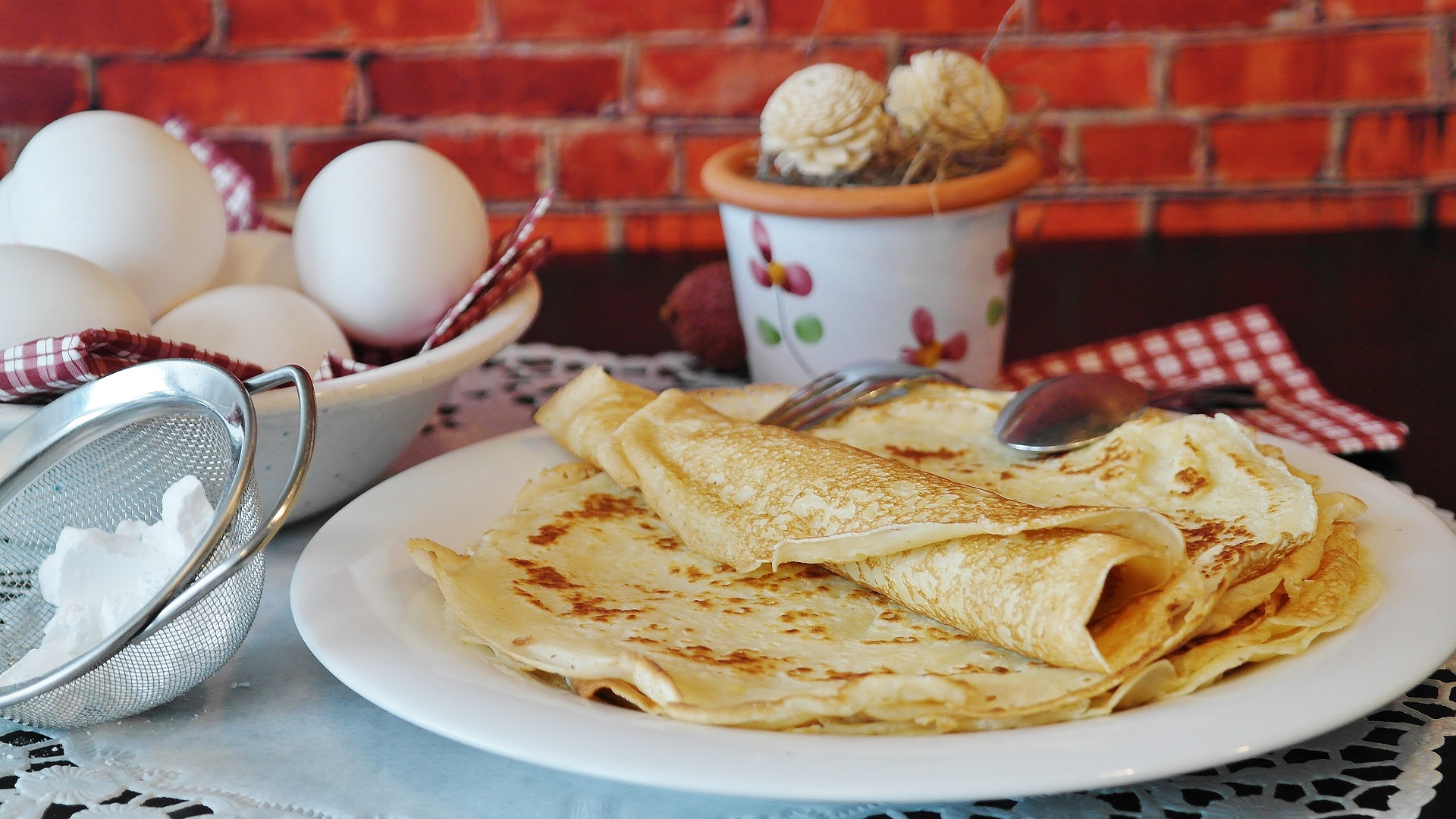 assortment of crepes folded on a plate
