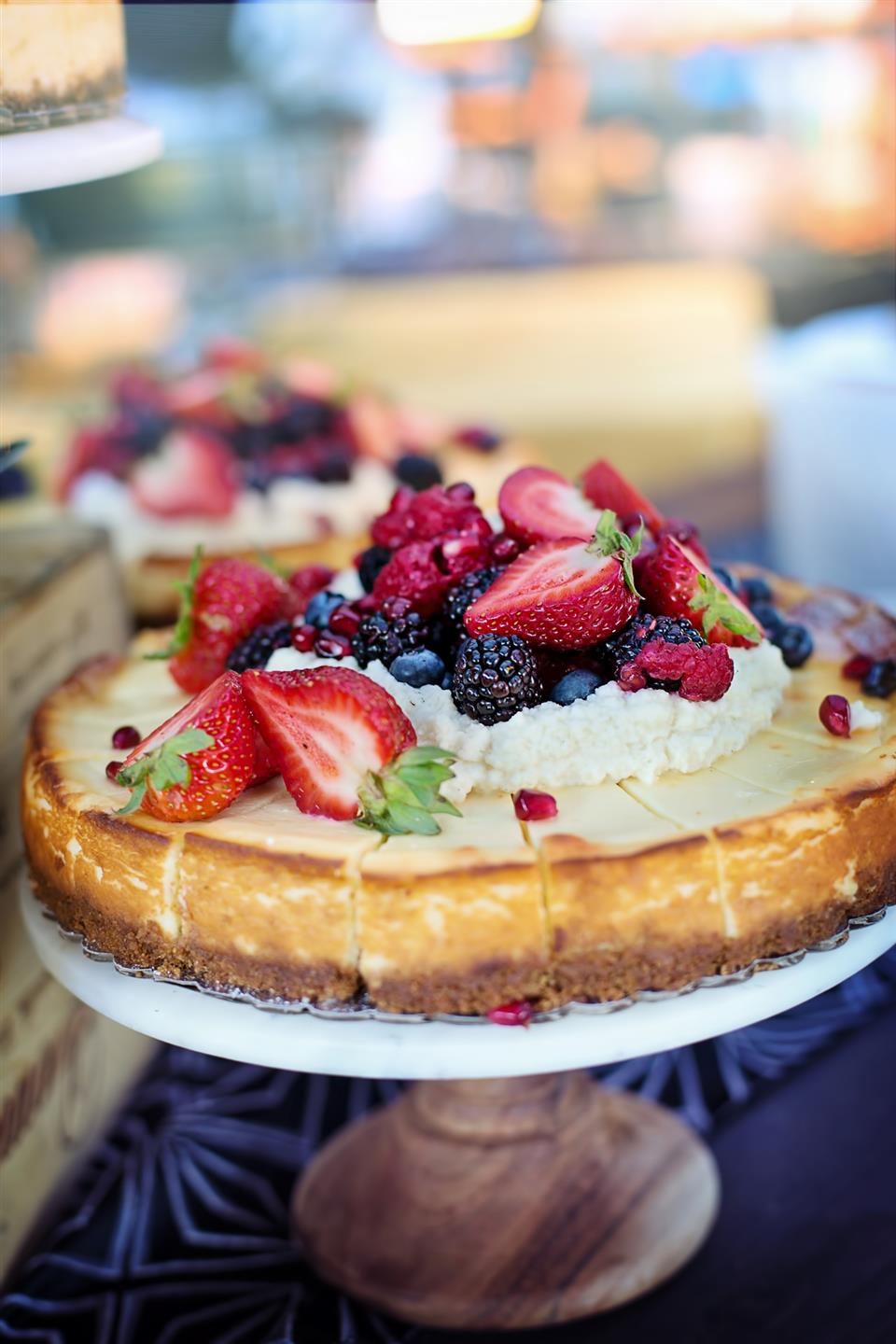 cheesecake topped with a variety of fruit