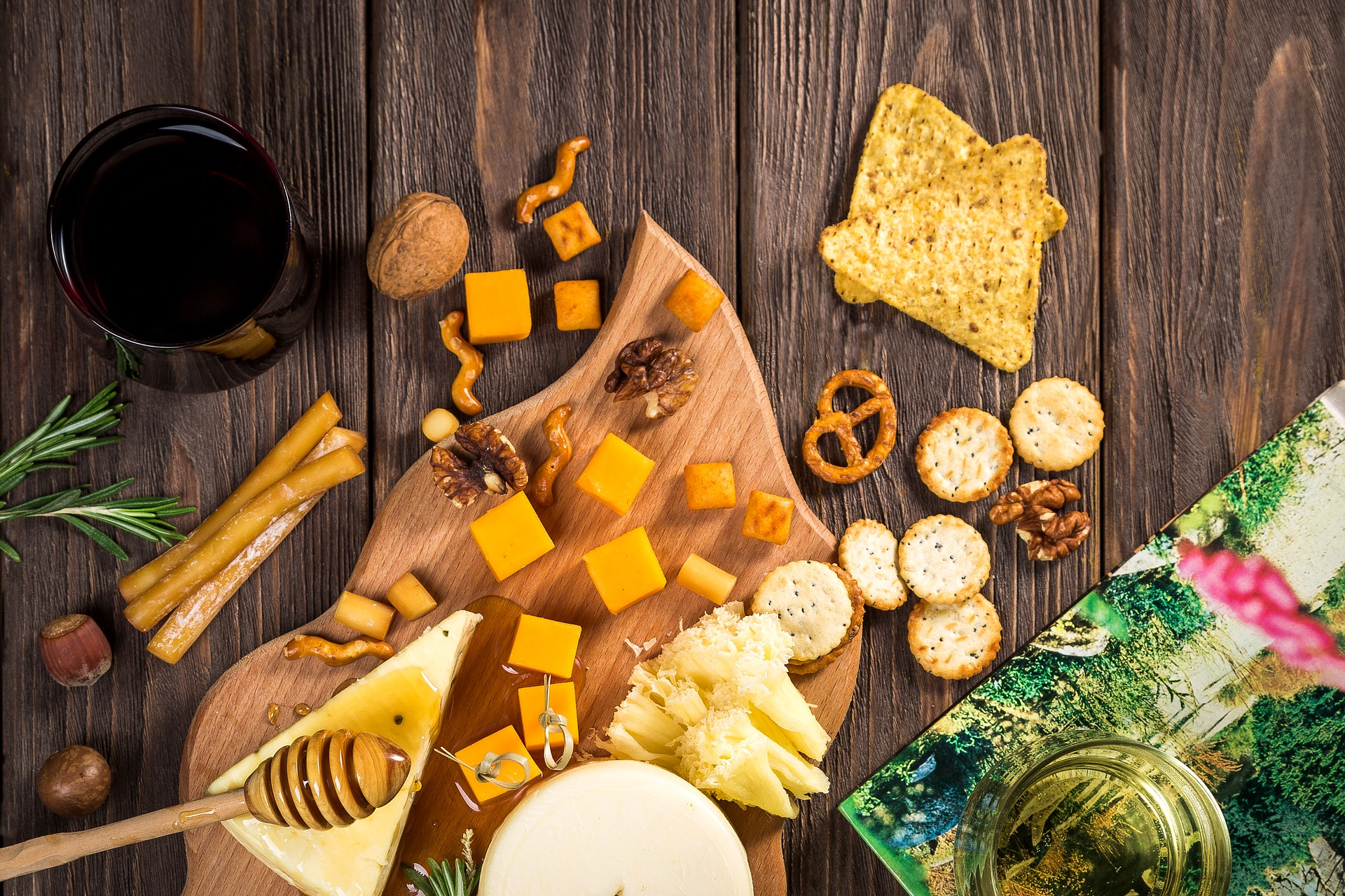 assortment of cheese, crackers, pretzels and honey