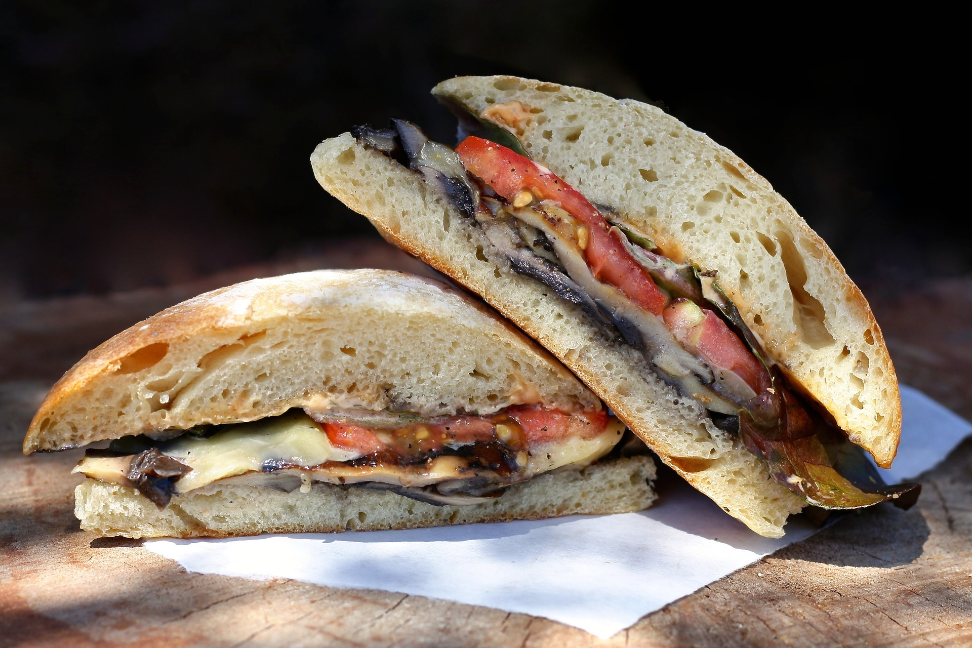 panini with tomato, mushrooms, and swiss cheese