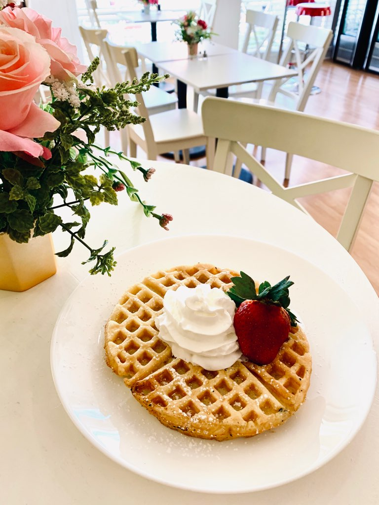 belgian waffle with whipped cream and strawberry