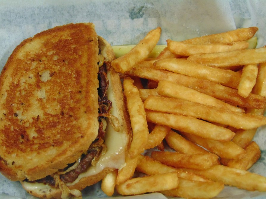 The Reuben Sandwich with a side of French Fries