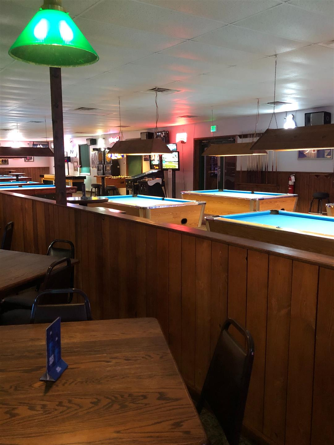 dining area overlooking pool tables