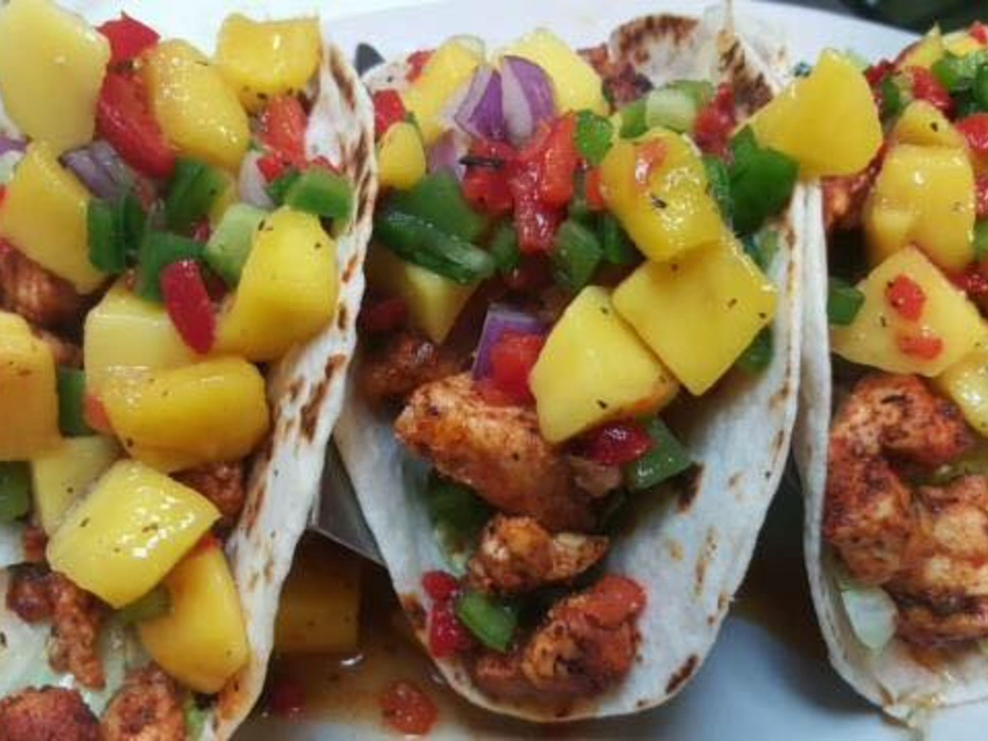 Fish tacoes with mango salsa on a plate