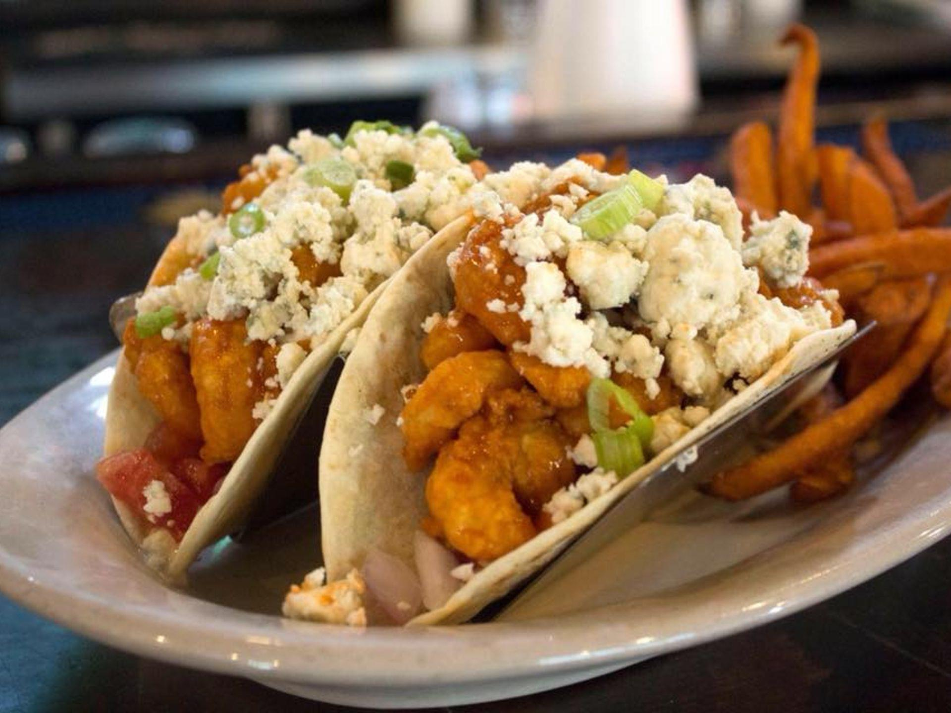 Shrimp tacos with feta cheese and sweet potato fries