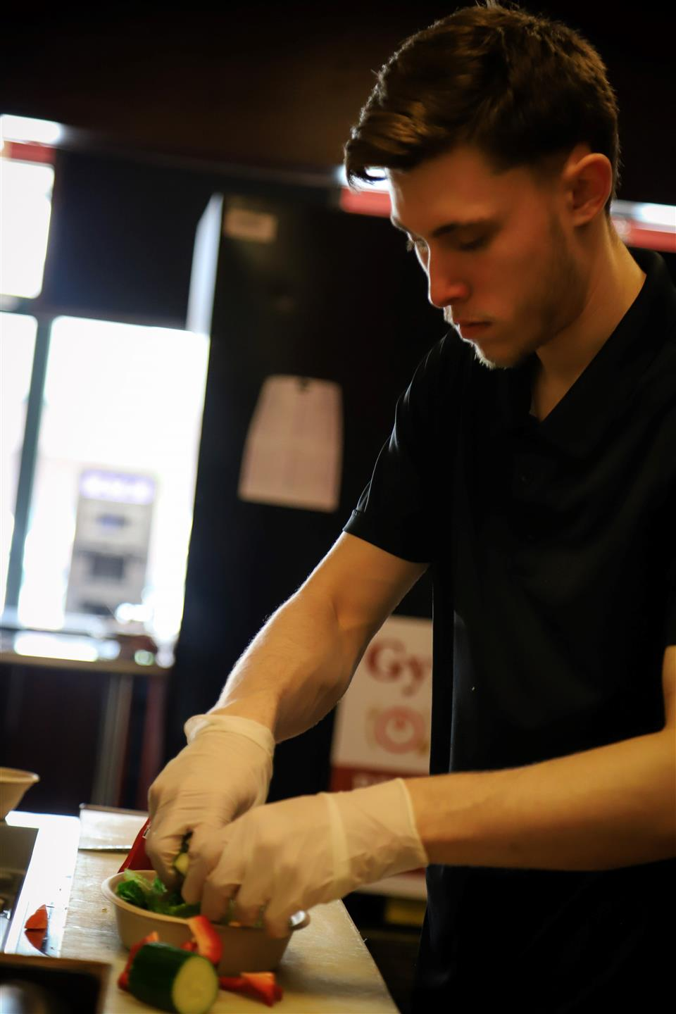 an employee prepping food in the kitchen