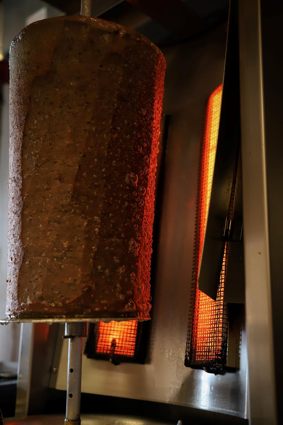 shawarma meat on a vertical broiler
