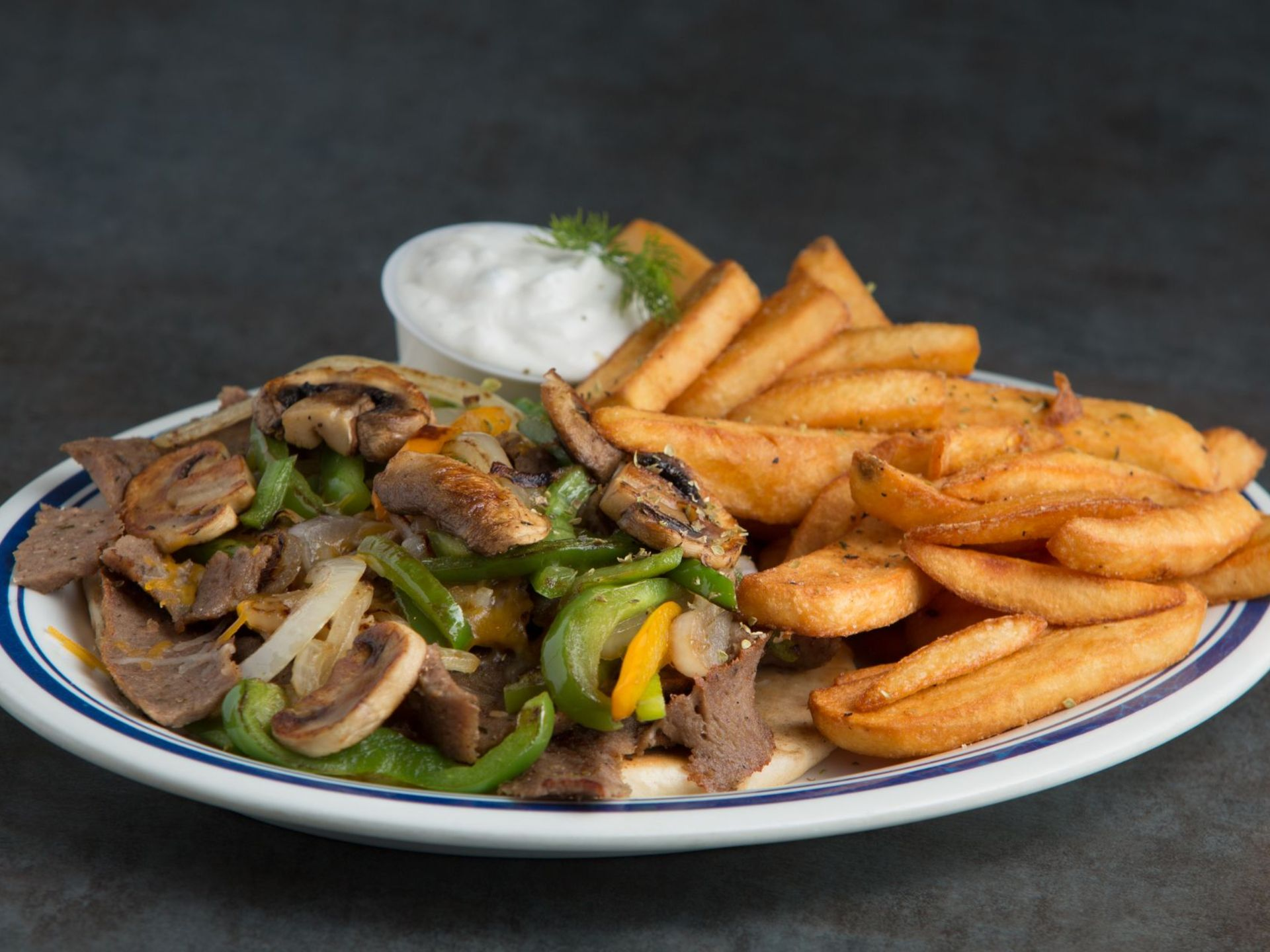 Gyro plate with peppers, onions, mushrooms and fries